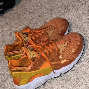 Orange and yellow Nike huaraches